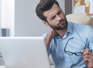 Man at computer with neck pain