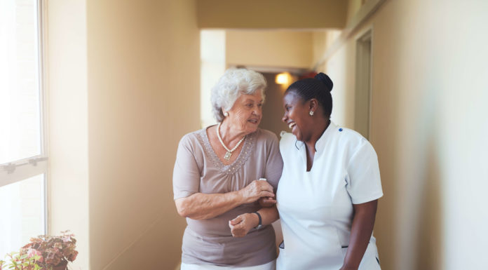 Caregiver walking with patient for National Healthcare Equality Week