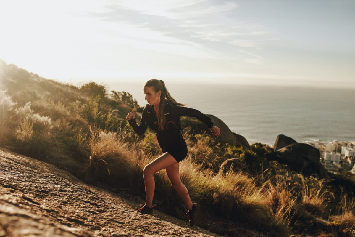 Runner's Guide to Prevent Pain runner pushing past discomfort uphill