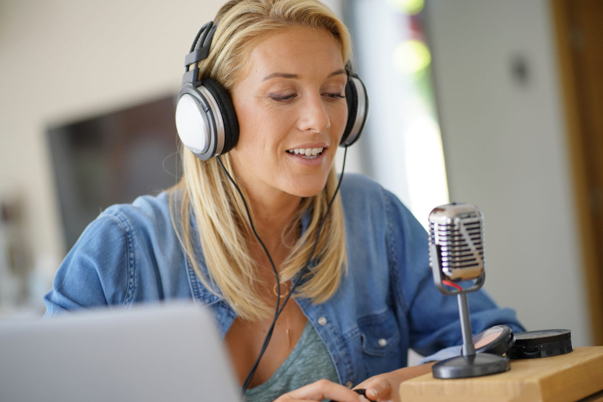 Best Podcasts on Chronic Pain woman recording a podcast