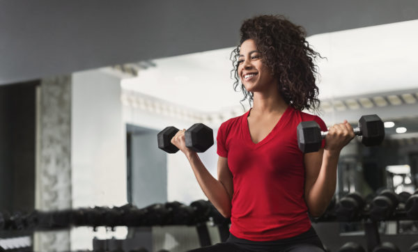 Common Mistakes in Pain Management woman exercising to manage pain