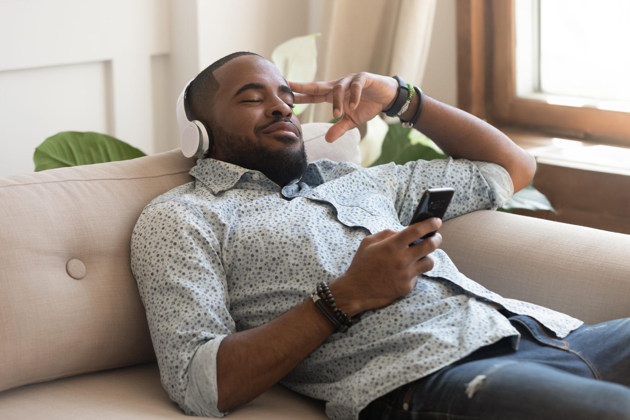 man listening to mindfulness meditation app