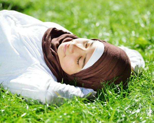 Muslim woman sleeping chronic pain and sleep debt