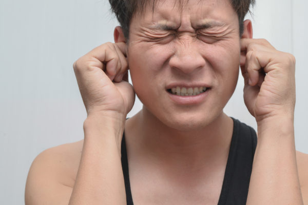 man with ear infection Managing ENT Pain