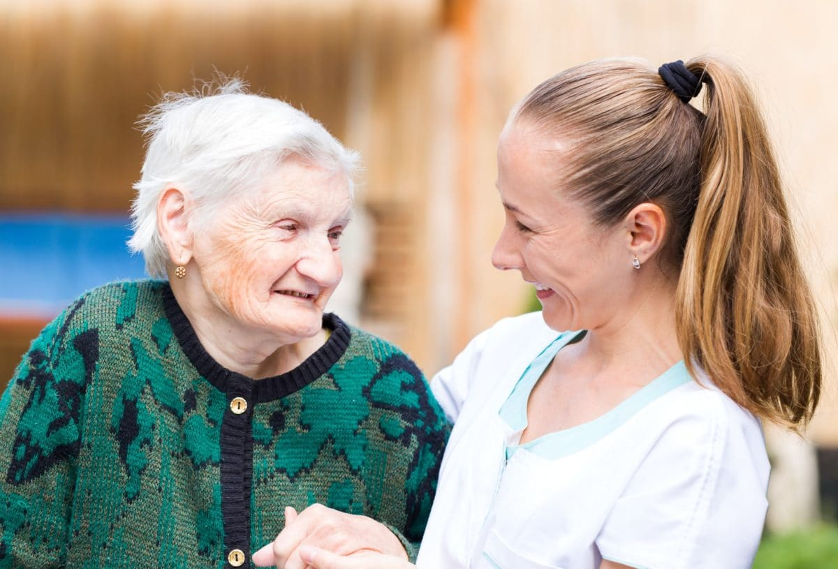 pain in vulnerable populations senior woman talking to health care provider