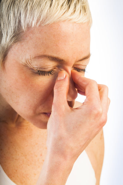 nose pain and headaches woman with sinus headache