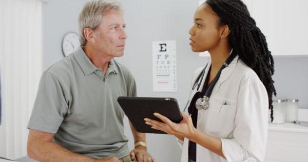 ulcer pain relief doctor and patient discussing treatment