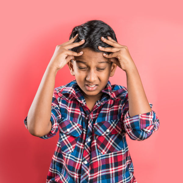 Treat Pediatric Migraines young boy with a migraine