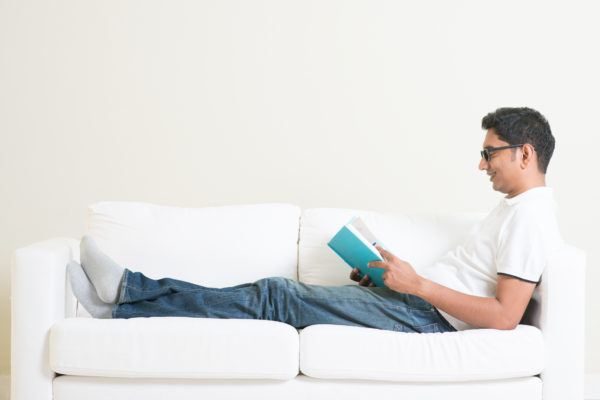 Common Mistakes in Pain Management man distracting himself from pain by reading