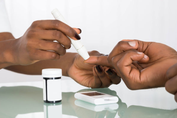 Black man having blood pressure taken 5 signs of vitamin 5 deficiency