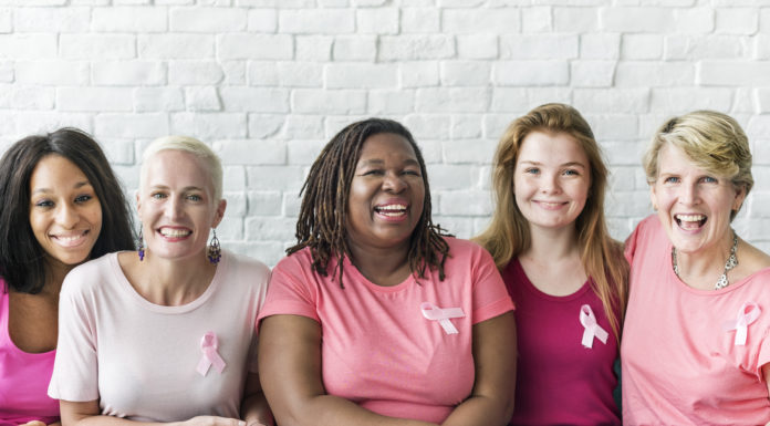 Multigenerational and multiracial women celebrating Breast Cancer Awareness Month