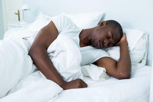 Black man sleeping chronic pain and sleep debt