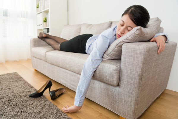 Asian woman sleeping on stomach chronic pain sleep debt