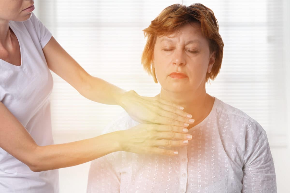 Reiki for Pain Management woman receiving Reiki treatment