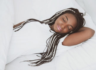 Black woman reducing chronic pain and sleep debt