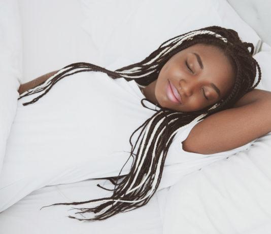 Black woman reducing chronic pain and sleep debt