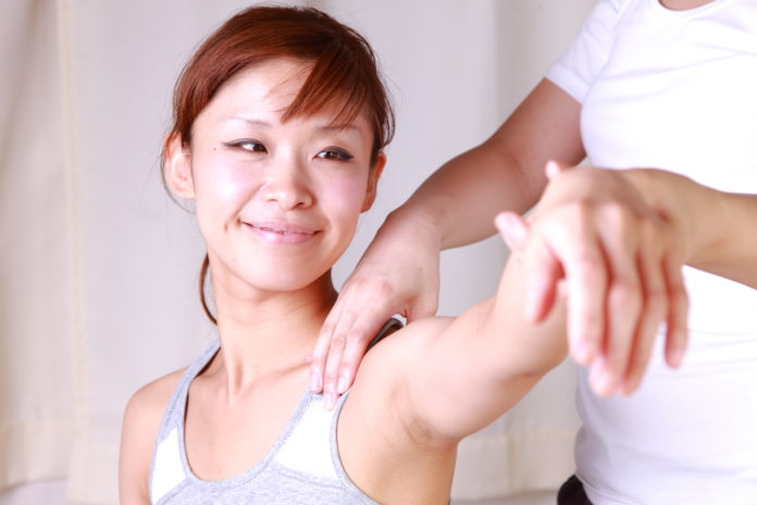 Asian woman getting physical therapy National Physical Therapy Month